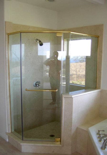 glass shower enclosure with gold trim